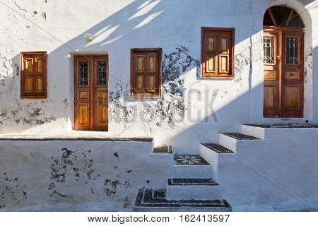Old house with traditional mosaics on the stairs, Mandraki village on Nisyros island.