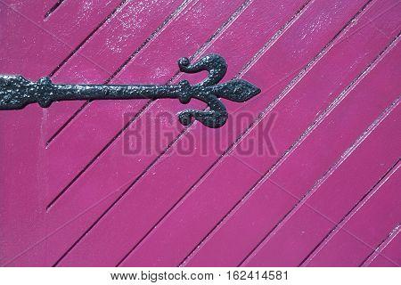 old woodden pink door with ferrule background