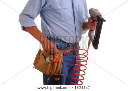 Carpenter Holding Nailgun