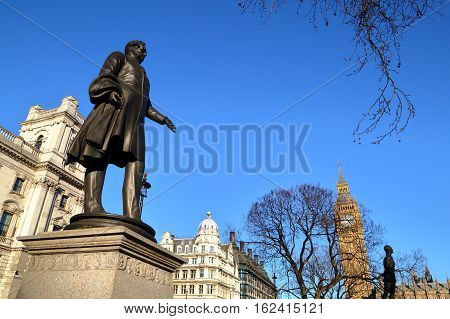 LONDON, UK - MARCH 16, 2014: Viscount Palmerston statue at Parliament Square with Big Ben in the background