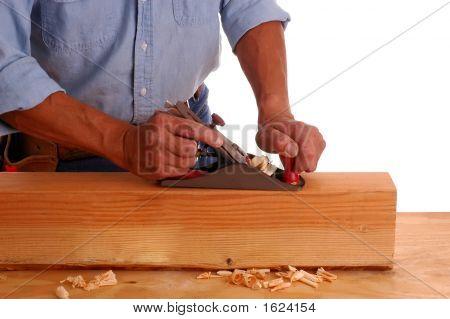 Carpenter Using Plane