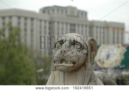 Moscow, Russia - May 12, 2006: Lion figure on monument of Victory over Napoleon at State Duma of Russian Federation background