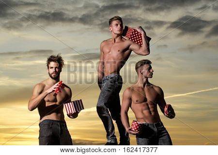 Muscular Men In Sunset With Boxes