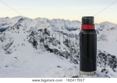 Thermos Of Hot Tea In The Mountains.