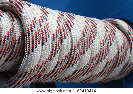 wrapped up white static rope on wheel