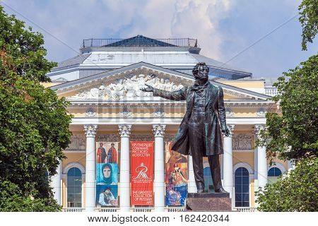 Saint Petersburg, Russia - July 26, 2014:  The Monument To The Famous Poet Alexander Pushkin And Mik