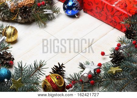 set of christmas or new year decoration with green fir tree with silver golden stars colorful present or gift with xmas balls on white vintage wooden background copy space