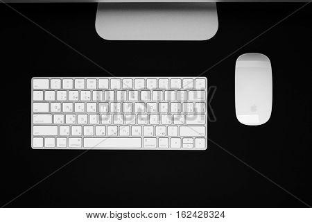 UKRAINE, RIVNE, December 2, 2016. Apple Computer iMac 27 retina display 5K keyboard and magic mouse on black table.