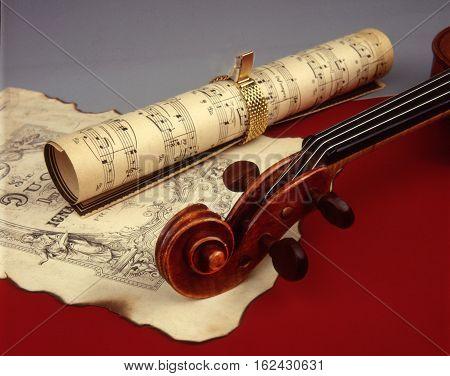beautiful violin and old yellowed sheet music