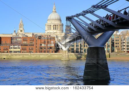 LONDON, UK - DECEMBER 31, 2015: View of St Paul's Cathedral and the Millennium Bridge