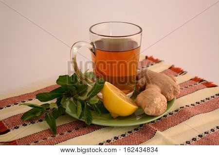 Useful hot ginger tea with mint and lemon