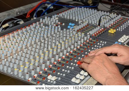 Mixer is controlled and controlled by a producer - close-up