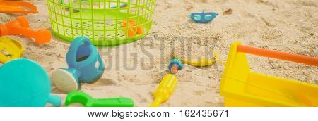 Colorful Sand box toys lying on the beach
