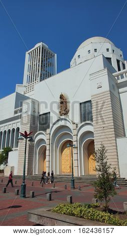 Ambato, Tungurahua / Ecuador - December 17 2016: People walking in front of the church of the Cathedral of Ambato. This church was rebuilt in 1952