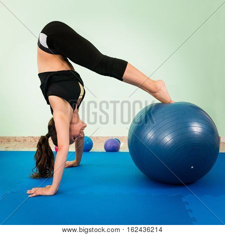 Exercising with fitness ball, toned image, square image