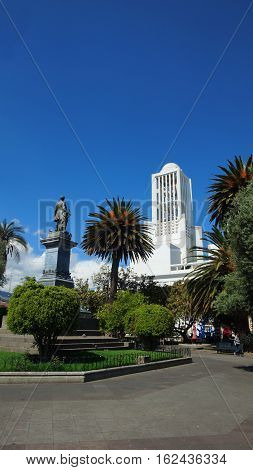 Ambato, Tungurahua / Ecuador - December 17 2016: View of the Montalvo Park with the church of the Cathedral of the city of Ambato in the background