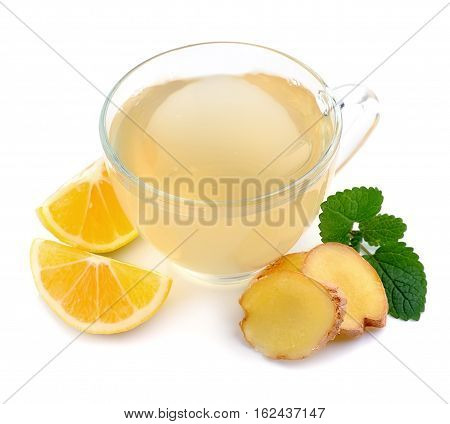 Cup tea with ginger and lemon isolated on a white background.