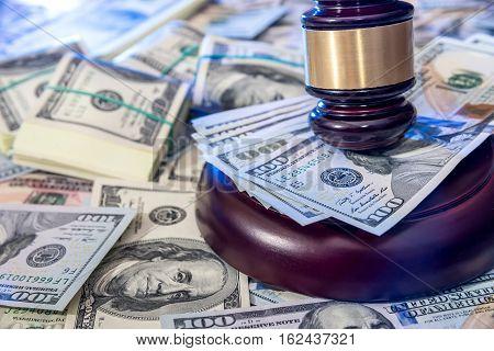 Wooden law gavel on us dollar money background