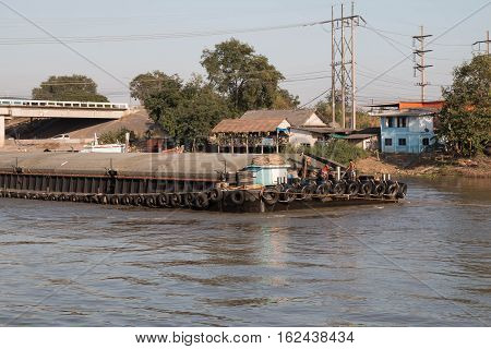 shipping boat Transport raw materials in river.
