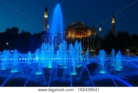 Colorful Fountain on Sultanahmet Square in front of Hagia Sophia Istanbul at night.