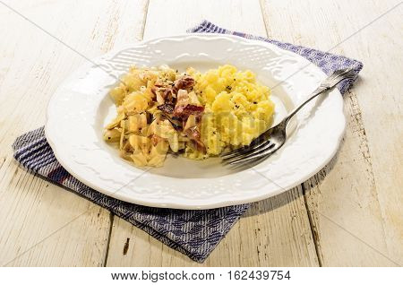 irish specialty mashed potato bacon and cabbage with fork on a plate