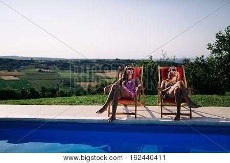 Beautiful women relaxing and sunbathing in summer