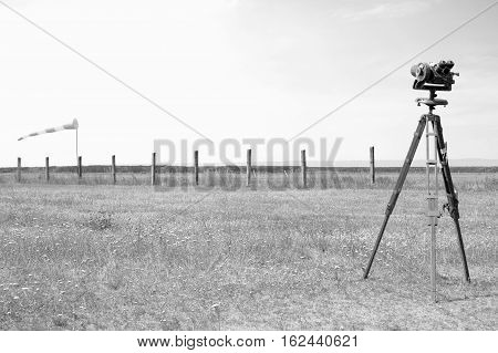 Red-white windsock indicating wind and Geodetic instruments on the airfield. Black and white.