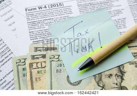 Tax Form 4 W with text tax time on note