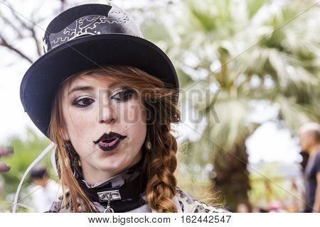 CAGLIARI, ITALY - June 1, 2014: Sunday at La Grande Jatte public gardens - Sardinia - portrait of a beautiful girl in the steampunk costumes