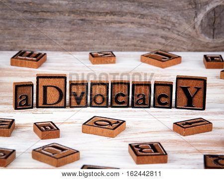 Advocacy from wooden letters on wooden background