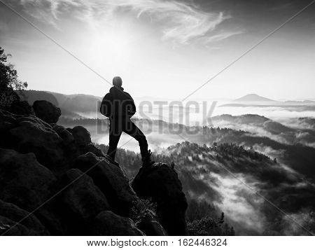 Hiker Stand At Heather Bush On Corner Of Empire. Fall Season