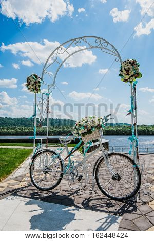 flower decorated bicycle at wedding registration ceremony.