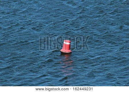 Marker buoy/This is red marker buoy in water dam.