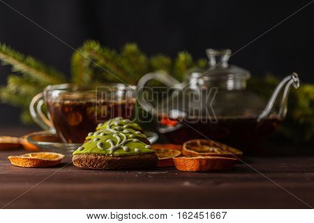 Transparent Glassy Tea Cup With Tea On The Black Background