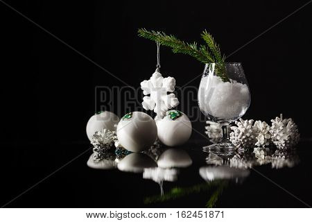 Modern Vintage High Contrast Photo Of Shiny, Bright Silver Christmas Balls Decoration Lying  On Dark