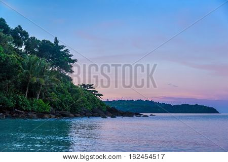 The tropical island in sunset at thailand