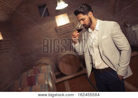 Wine Maker Testing Wines