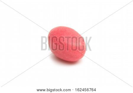 chewing red candy on a white background