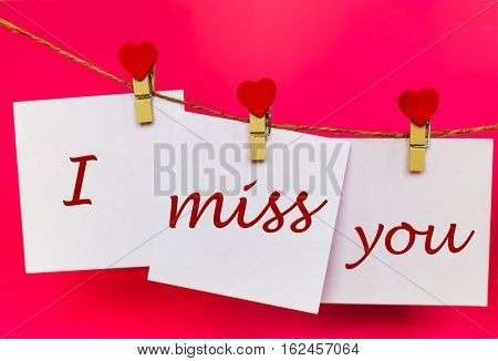 Miss You Text On Stickers Hanging On Heart Shape Pins