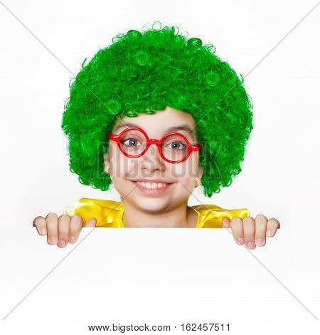 Cheerful girl in a green wig and red glasses on white background