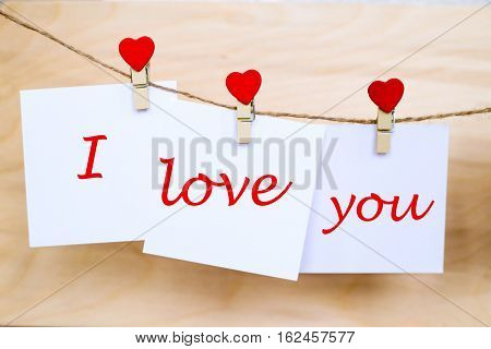 Love You Text On Stickers Hanging On Heart Shape Pins