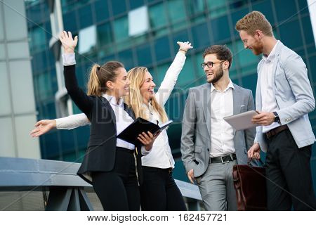 Successful happy young cute business people outdoor