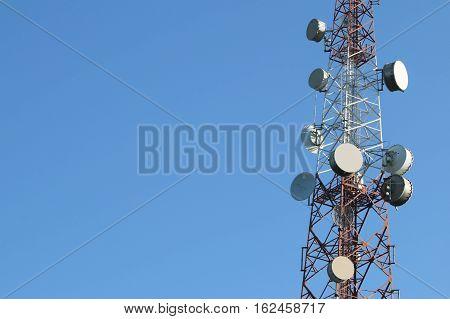 Satellite Dish on Telecommunication Radio antenna Tower, Copyspace at the left.