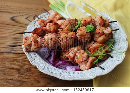 Grilled chicken kabob on a skewer on plate