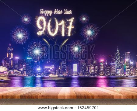 Happy New Year 2017 Fireworks Over Cityscape At Night With Empty Wood Plank Table,mock Up Template F