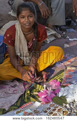 AHMADABAD, INDIA - OCTOBER 31, 2007: Women selling colorful paint powder for the Hindu festival of Holi at a street market in Ahmadabad, Gujarat, India.