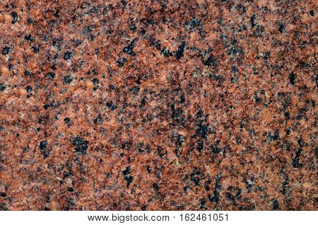Natural stone granite background with bright hard rock texture.