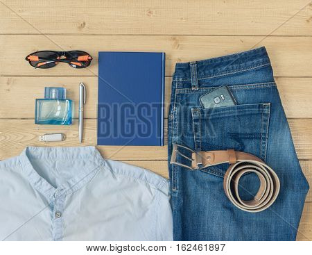 Men's Clothes And Accessories On The Wooden Floor.