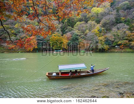 Boatman Punting The Boat On River In Kyoto