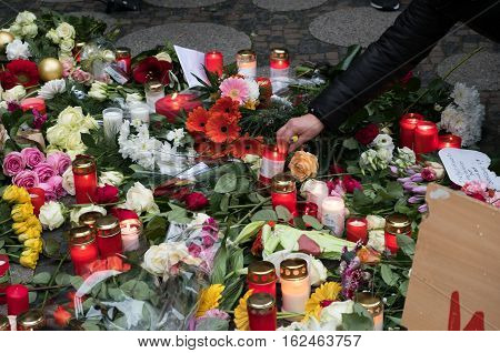 Berlin Germany - december 20, 2016: Candles and flowers at the Christmas Market in Berlin the day after a truck drove into a crowd of people.